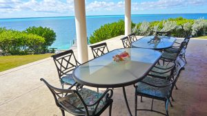 Outdoor dining area overlooking the sea of Abaco